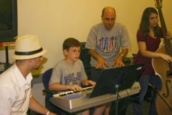 summer_jazz_08_-_students___teacher_John_Mastroianni_plus_intern_Chris_Marrone__hat_.JPG